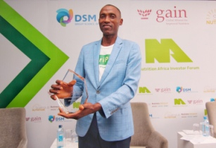 Ope Olanrewaju Kennie O Cold Chain Logistics holds the Grand Prize trophy for the SUN Pitch Competi